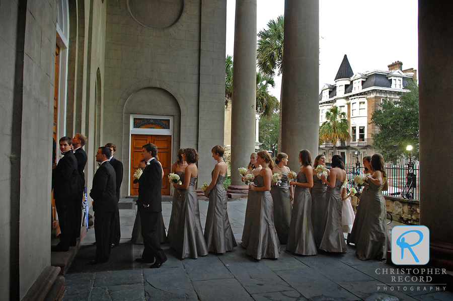 The bridal party enters the church