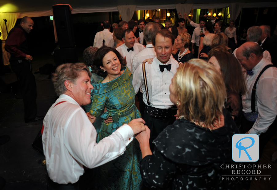 Lucy's dad and mom dance with friends