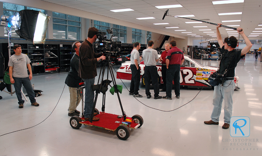 The crew films in the race shop