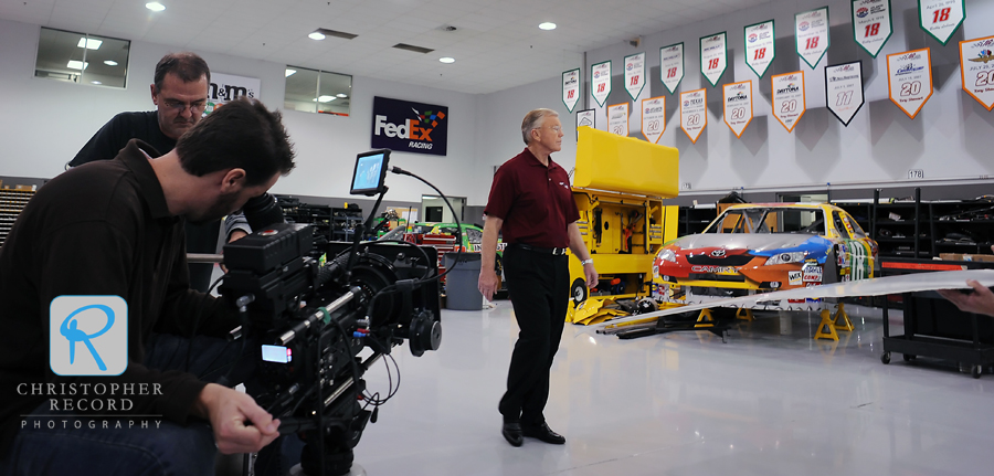 Gibbs, whose teams has won 3 Cup Series chamionships, is filmed walking through his shop