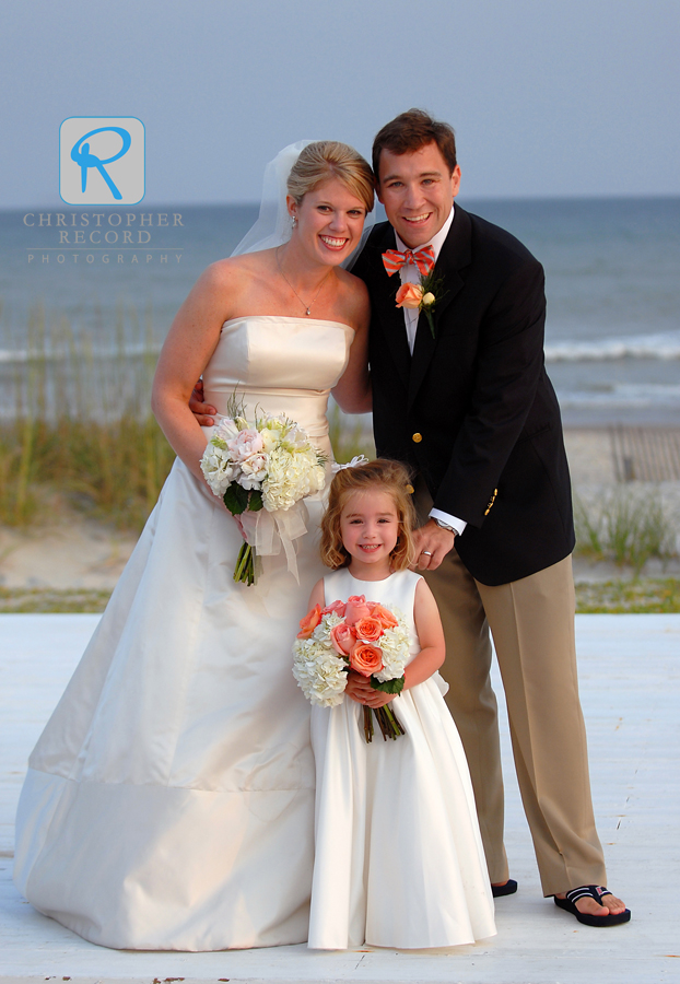 Laura and Mike with their flower girl at The Coral Bay Club at Atlantic Beach