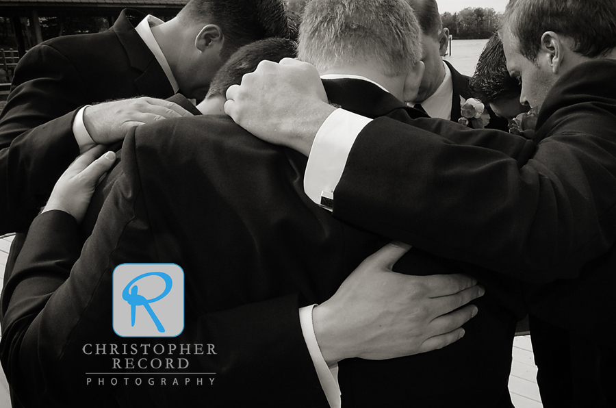 The men pray before heading to the ceremony