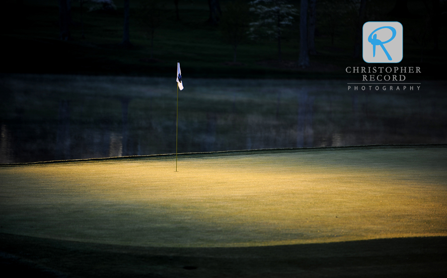 Pretty light illuminates the pin on the 17th green