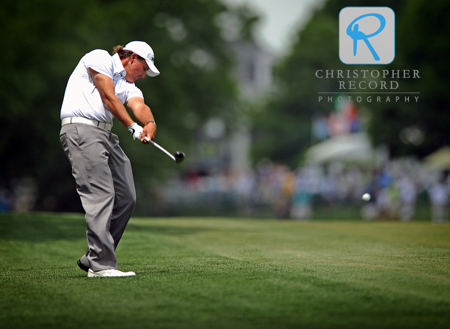 Phil Mickelson fires his second shot to the par-5 9th hole during an early round