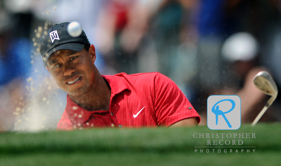 Tiger blasts from a bunker on the 5th hold during the final round