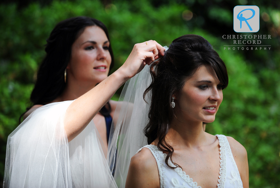 Stephanie helps Kelsey with her veil