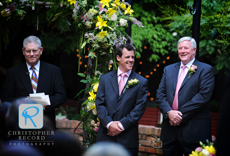 Benny and his stepfather and best man Barry take their positions