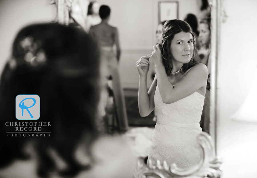 Catherine fixes her hair in the bride's room