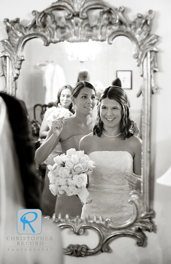 Melissa, Catherine's sister and Matron of Honor, helps with some finishing touches