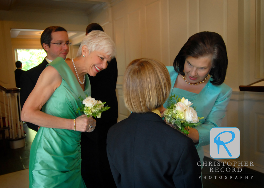 Stephen's mother, left, and Catherine's mother help one of the young ushers get ready