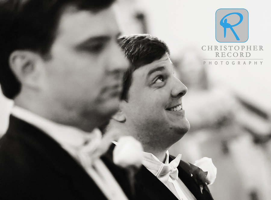 Stephen makes a quick glance skyward as he readies to walk into the church