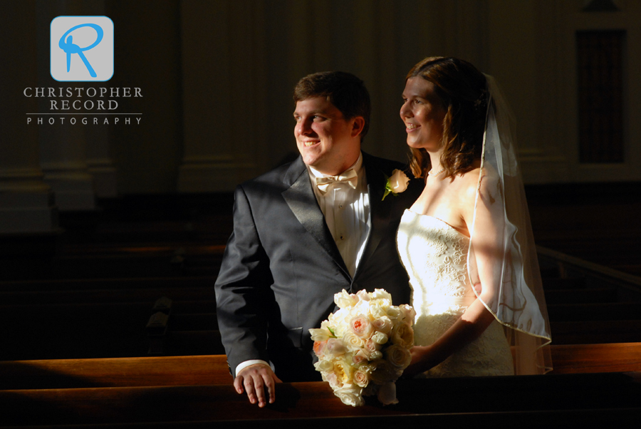 Catherine and Stephen captured in some pretty light inside the church