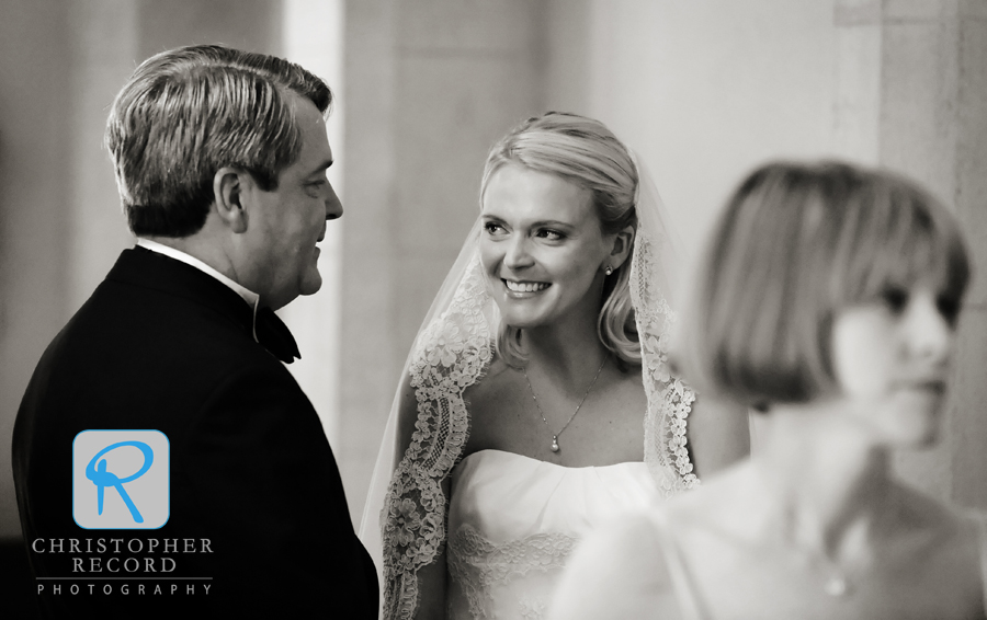 Katie and her father share a nice moment as they prepare to walk down the aisle