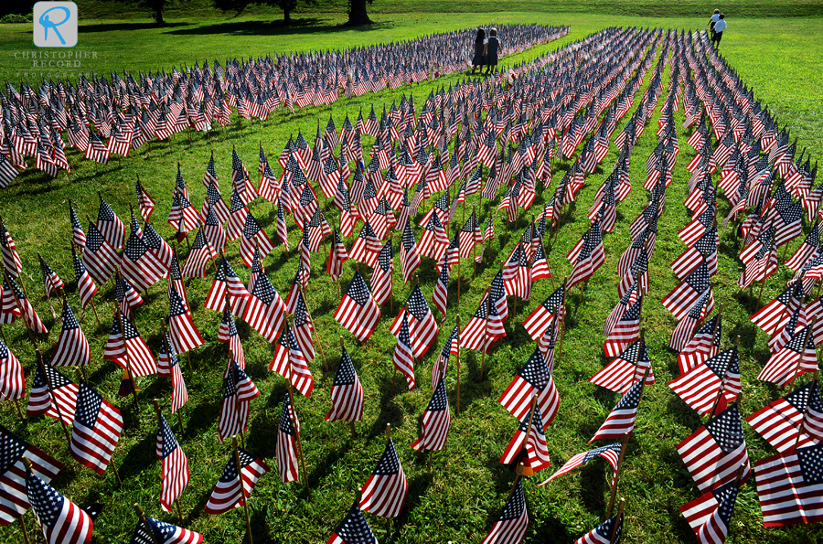 Children walk among some of the 2,997 American flags used to represent the twin towers