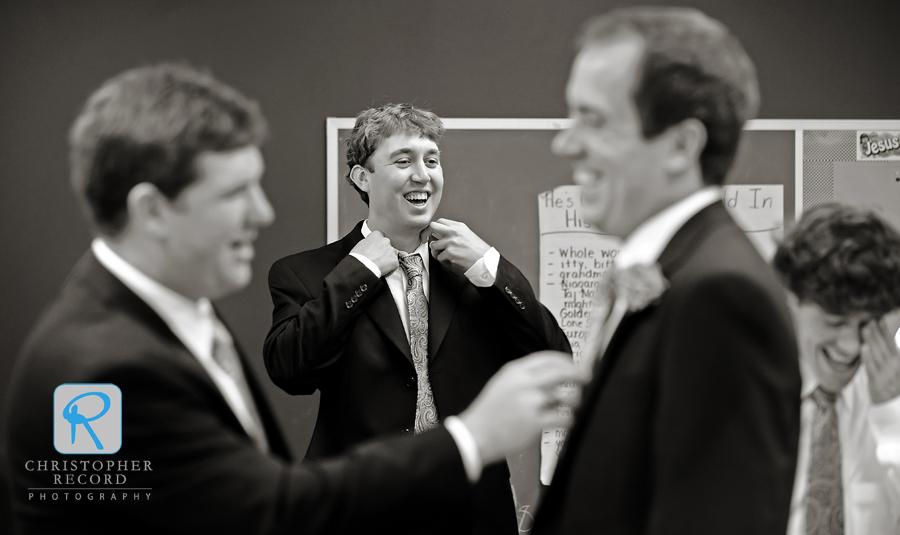 Thomas jokes with the groomsmen as they get ready