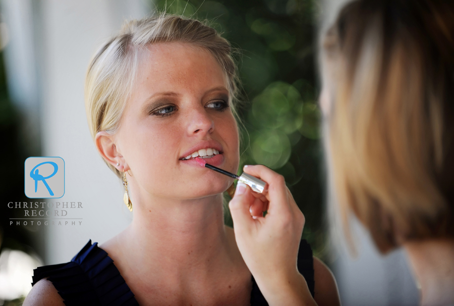 Stephanie touches up her sister and Maid of Honor Sarah's makeup