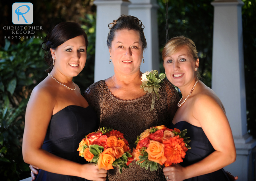 Thomas' mother with his sisters Mary Beth, left, and Jessica