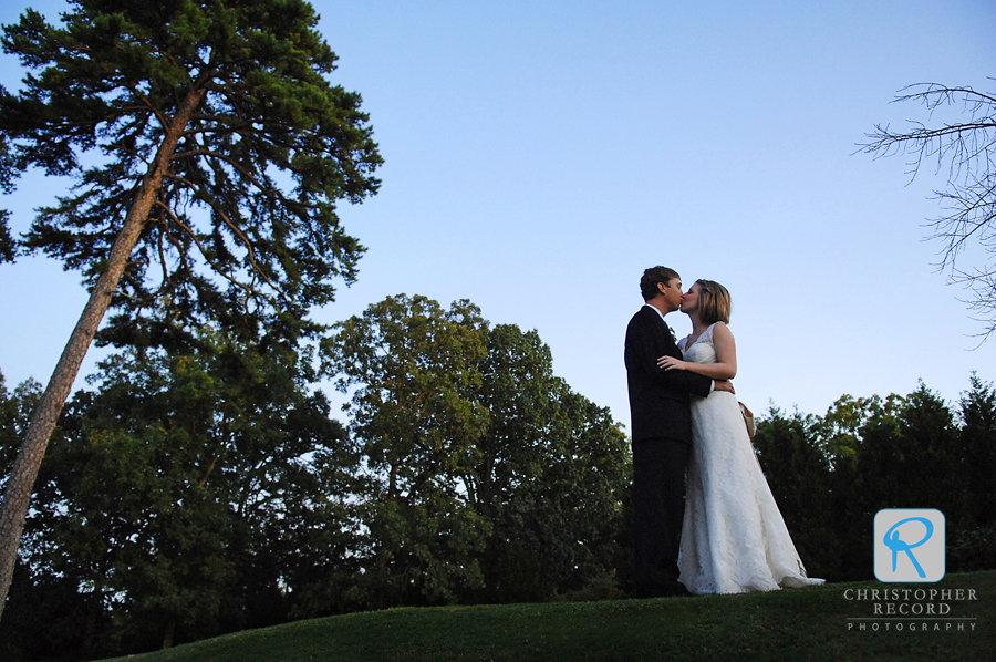 The new husband and wife share a kiss outside Rock Hill Country Club