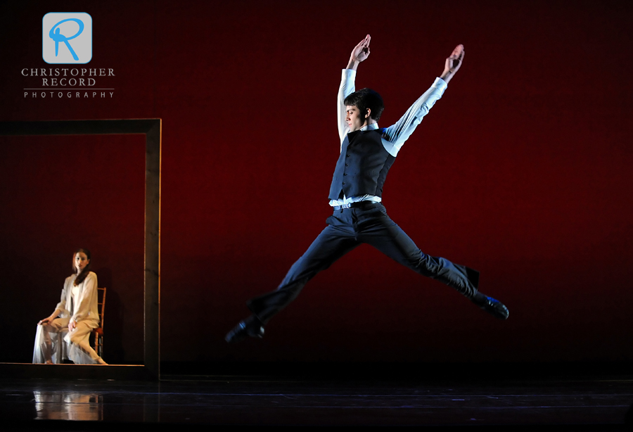 Dustin Layton leaps as Traci Gilchrest is framed onstage
