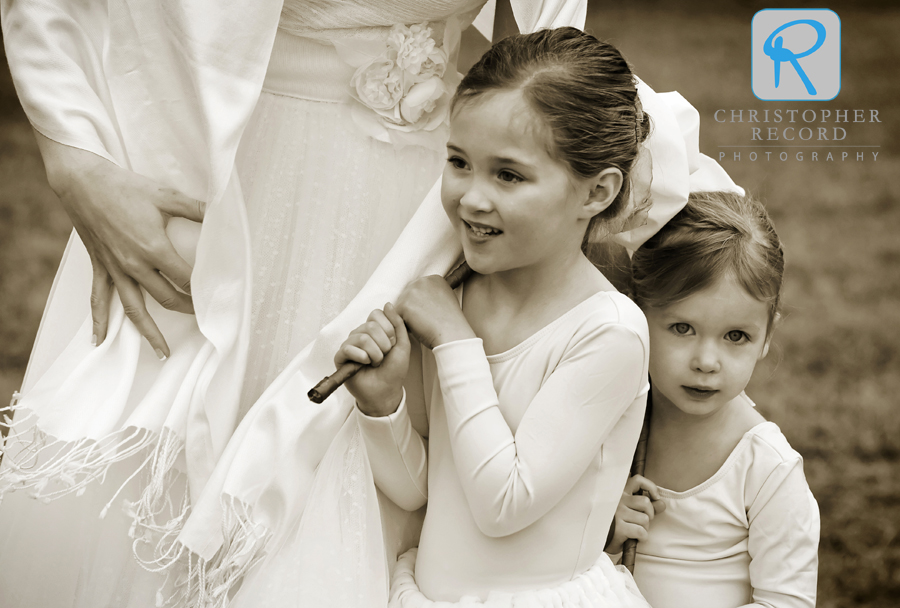 Liz helps keep the flower girls warm while pictures are taken