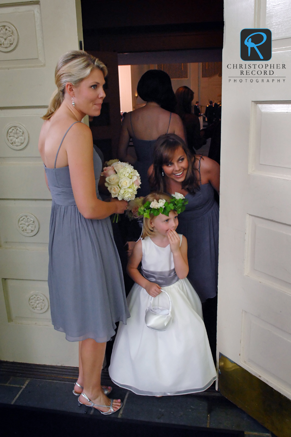 Brad's sister Katie, left, Elizabeth's sister Denard and flower girl Kendall had to check the bride too