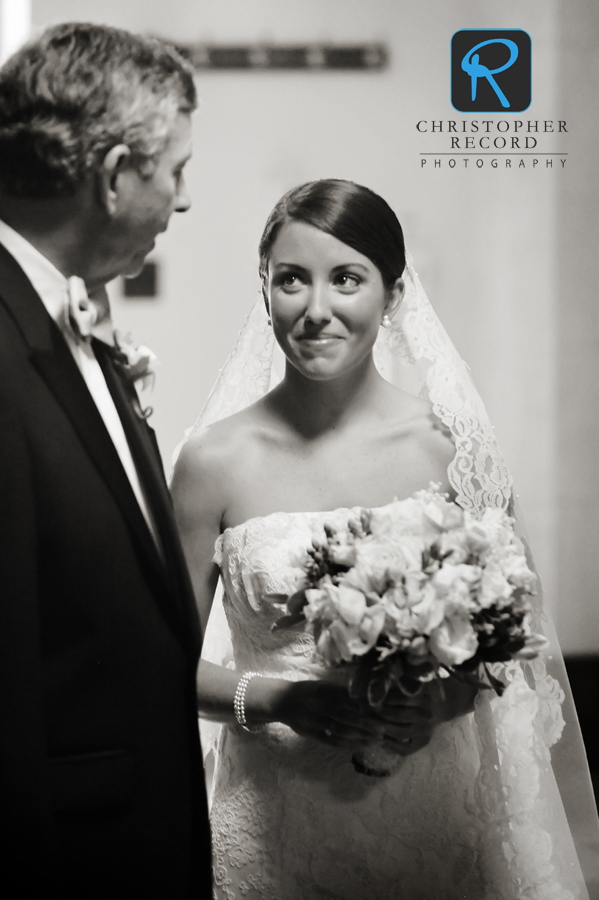 Tanner and her father talk as they prepare to walk down the aisle