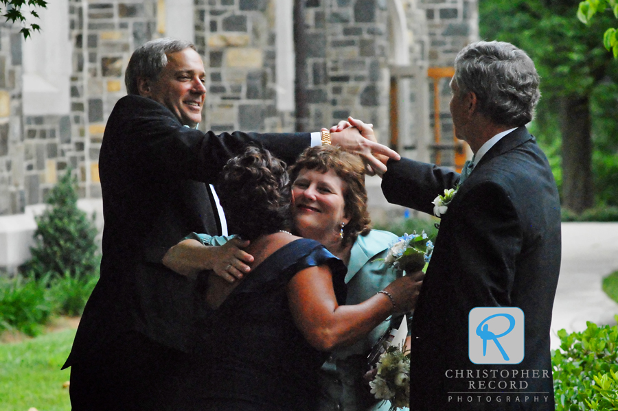 As I followed the couple, Laura-Chase captured this nice moment of both sets of parents celebrating