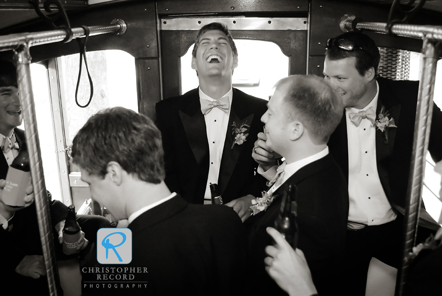 The groomsmen have some fun as they head to the reception