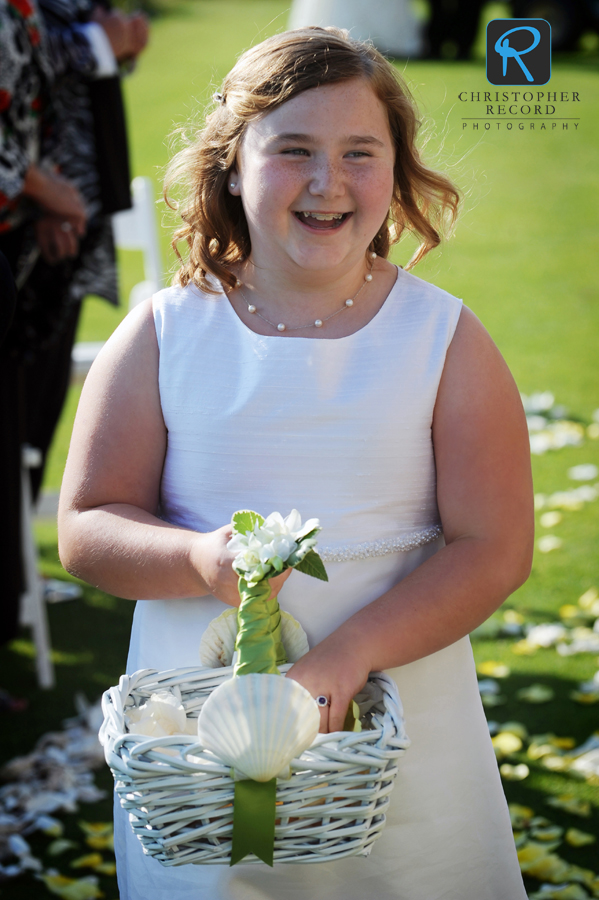 The flower girl, Mike's niece, makes her entrance