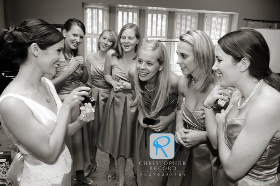 Ann shows her new earrings to her bridesmaids