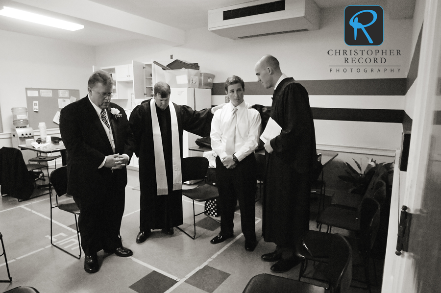 Byers and his father Johnny, far left, pray with the ministers prior to the service