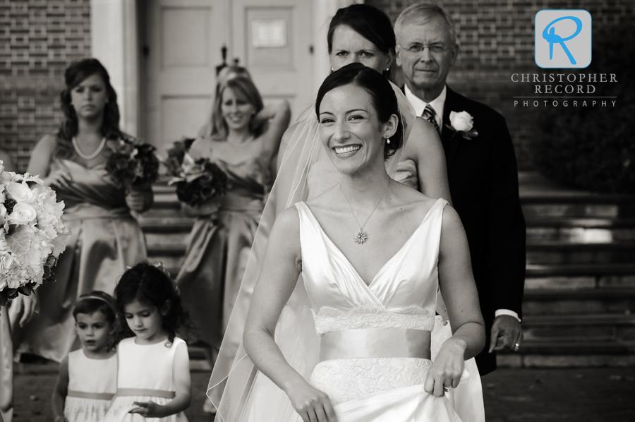 Ann's joy shows as she walks to the church entrance