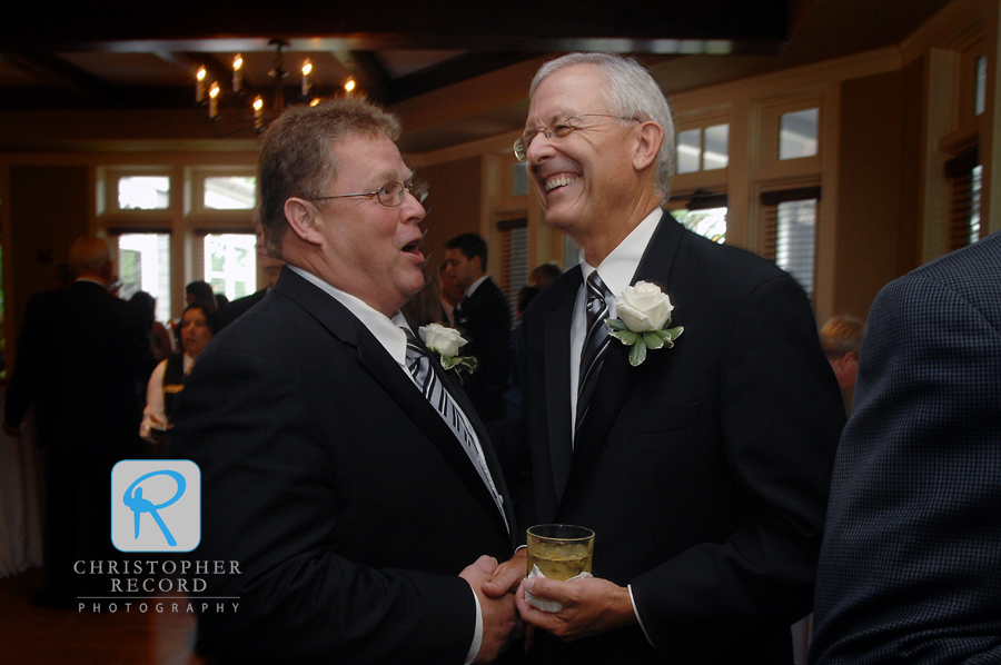 The fathers, Johnny and Hart, share a laugh at the cocktail hour