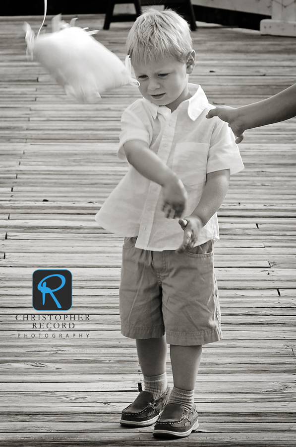 The first ring bearer decided he wasn't going to carry his pillow - so he flung it down the aisle