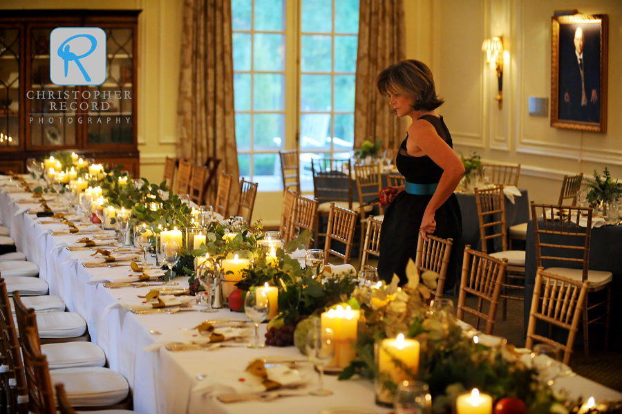 John's mother Emily checks the head table for the rehearsal dinner at The Duke Mansion