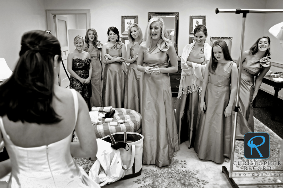 The bridesmaids check the dress