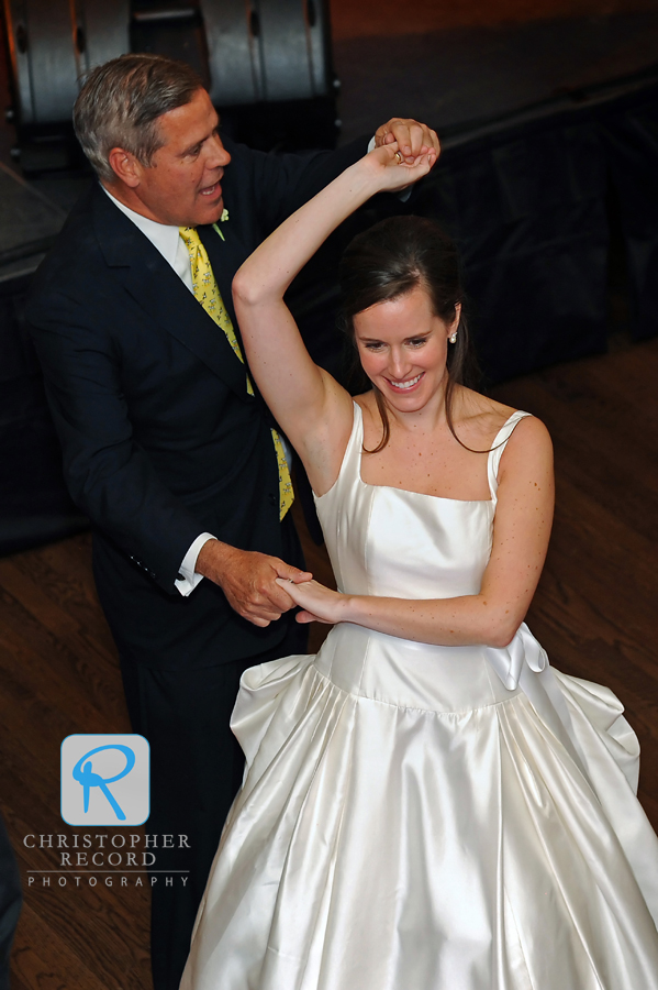 Sarah dances with her father