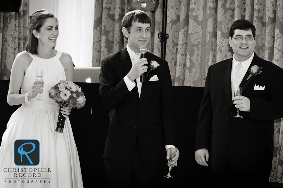 Jade and Jim's brother look on during Jim's speech in another image from Adam