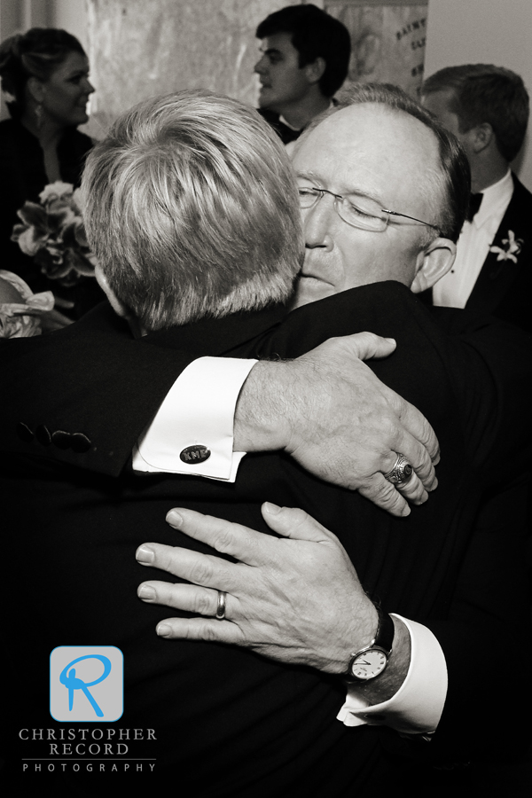 And John gets a similar greeting from his father, also his Best Man
