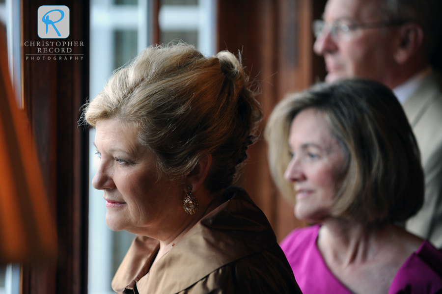 Ellen's parents and Scott's mother watch the guests arrive