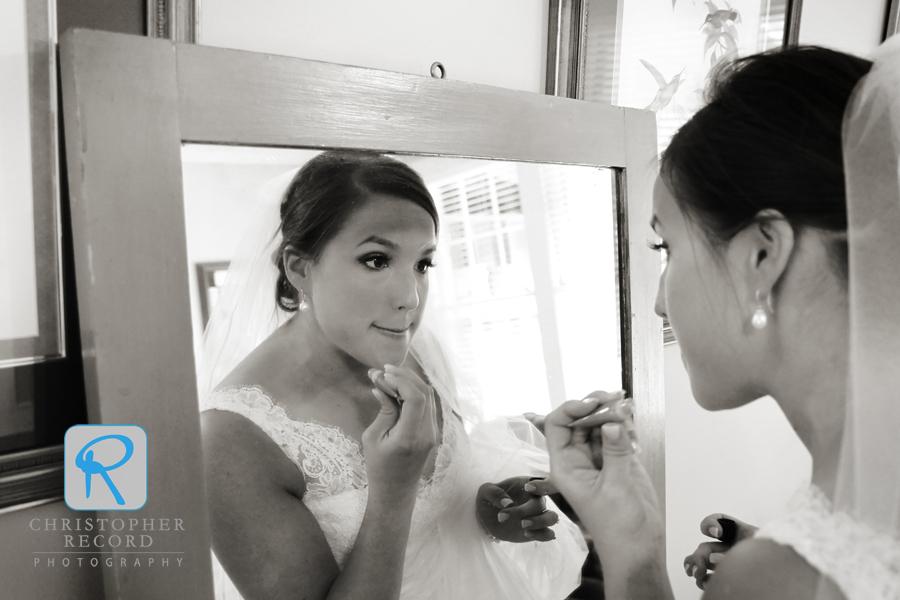 Christina touches up her makeup