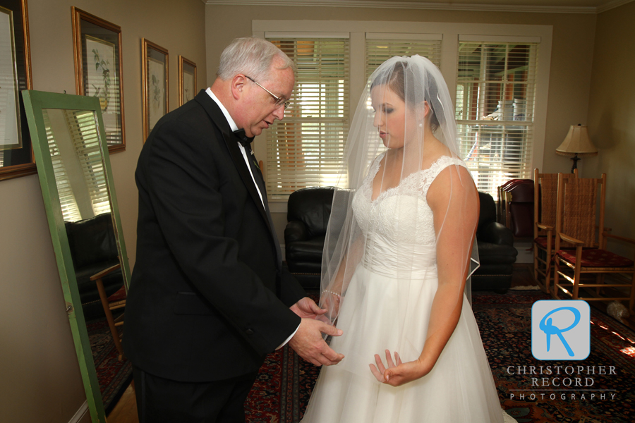 Christina and her father go over the ceremony details