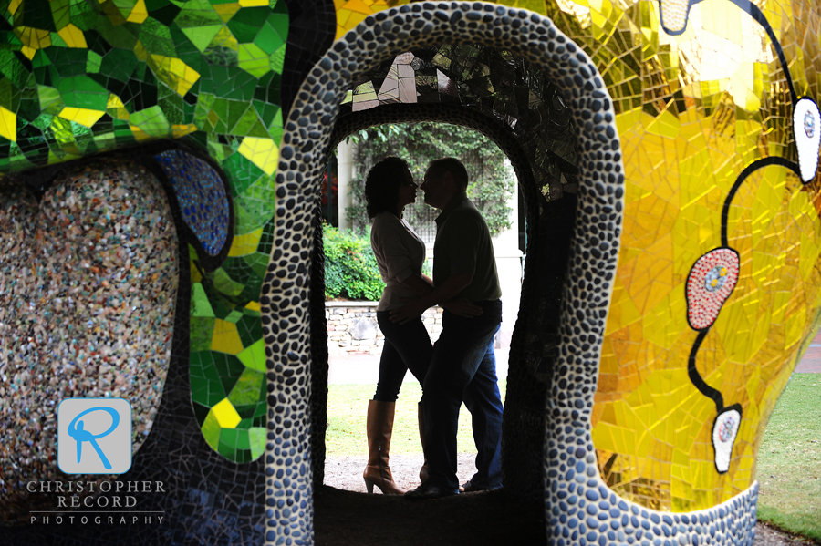 Melissa and Dan framed by a Niki de Saint Phalle sculpture in Charlotte