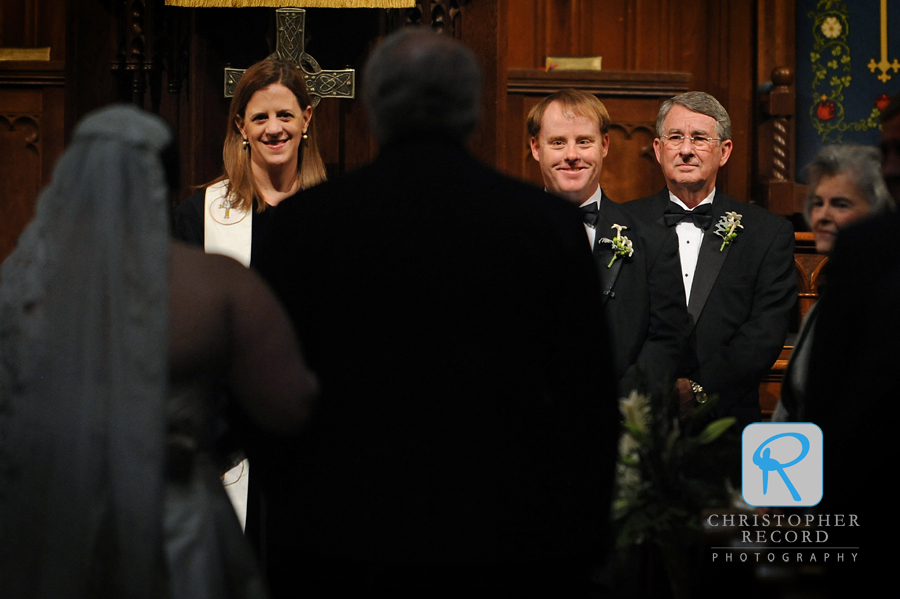 Patrick watches his bride enter as the Rev. Katherine Kerr and his father look on