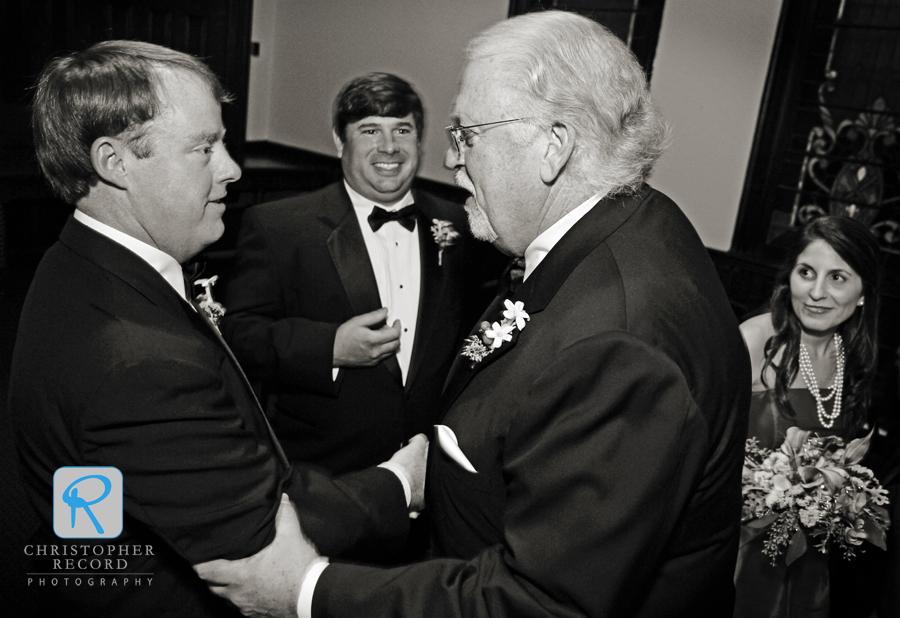 Emily's father, Paul, congratulates Patrick