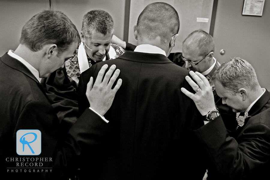 Michael's brother and brother-in-law and ministers Mitch White and Mike Moses gather to pray