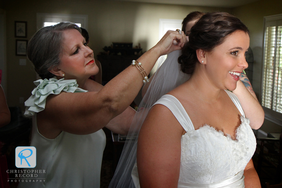 Sherry places the veil on her daughter