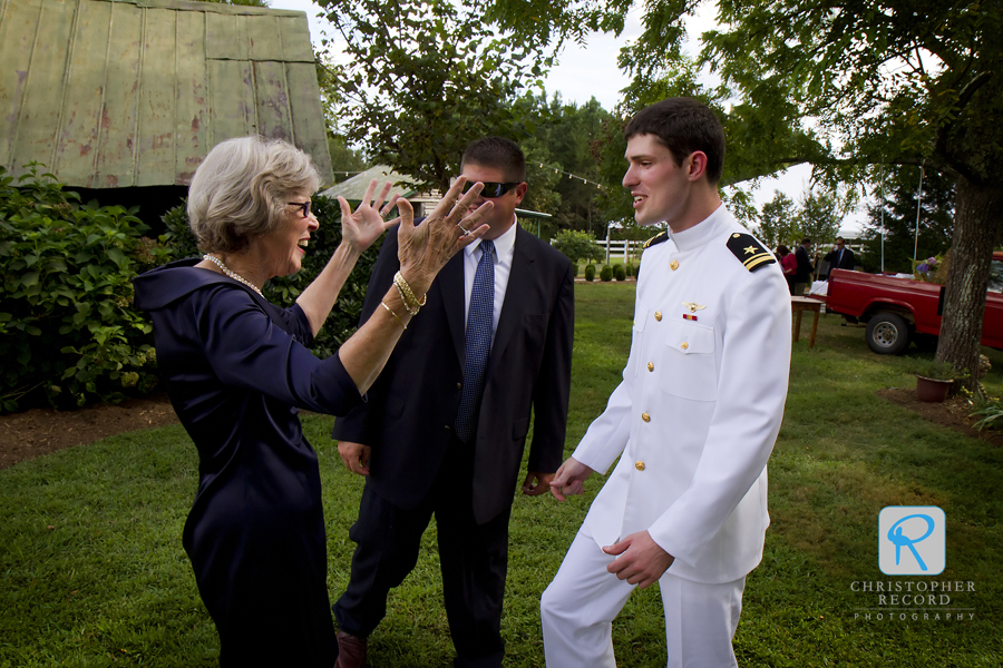 Mary Ellen's aunt, who hosted the event, greets William before the service