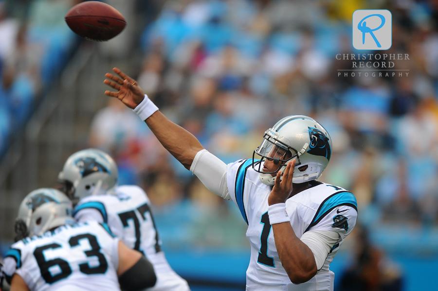 Cam Newton fires a pass