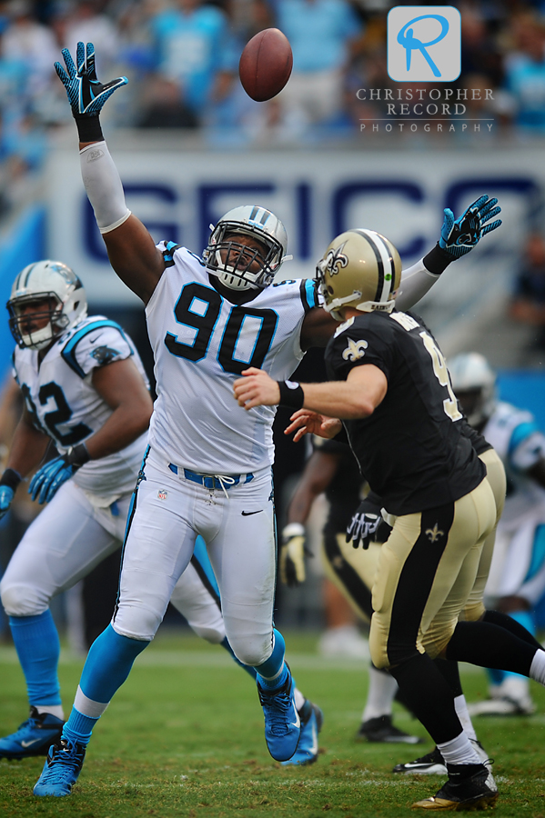 Panther Frank Alexander (90) knocks down a Drew Brees pass